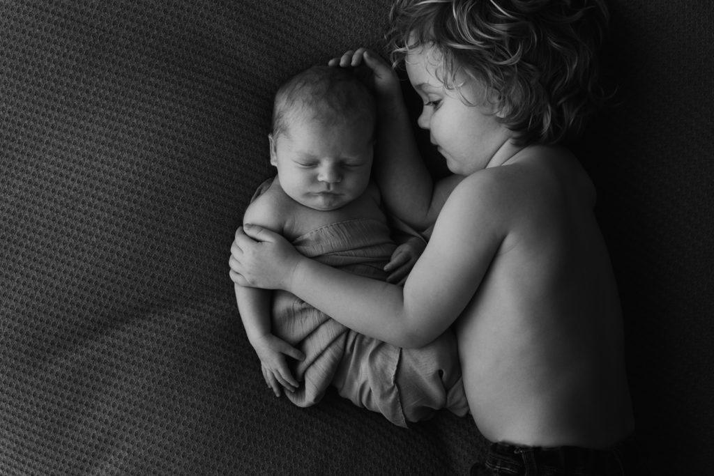 Newbornfotograaf broertje